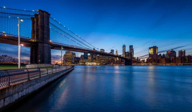 Skyline New York by Night from Brooklyn Bridge