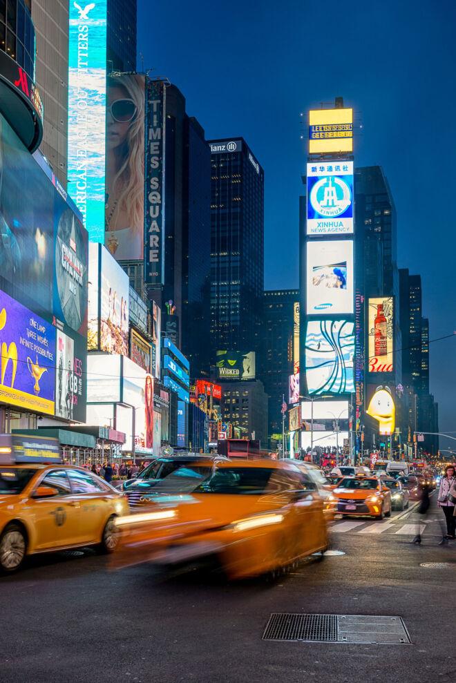 Yellow cab New York by night